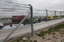Sportauto crasht en vliegt in brand op Circuit Zandvoort